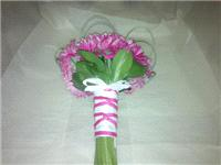 Flowers. Bride's gerbera bouquet (satin and ballerina wrapped). Wedding packages available.
