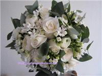 Flowers. Bride's white bouquet. Wedding packages available.