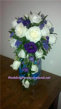 Flowers. Purple-and-Ivory drop bouquet. Wedding packages available.