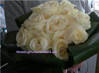 Flowers. Bride's Ivory Rose bouquet. Wedding packages available.