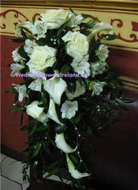 Flowers. Bridal Shower bouquet with callas, roses and pearl-strand detailing. Wedding packages avail