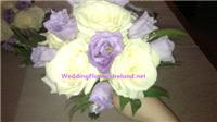 Flowers. Bridesmaids Lavender-and-Ivory hand-tied bouquet. Wedding packages available.