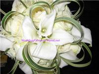 Flowers. Bride's bouquet (callas, roses and grasses). Wedding packages available.