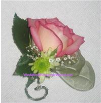 Flowers. Rose Corsage (with chrysant and co-ordinating ribbon and wire accents). Wedding packages av