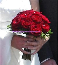 Flowers. Bride's Rose Hand-Tied bouquet (with diamante accents). Wedding packages available.