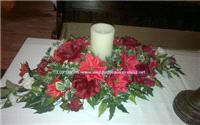 Flowers. Christmas wedding centrepiece. Wedding packages available.