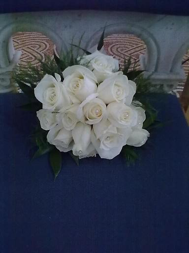 Flowers, Bride's bouquet with pearls inset into roses. Wedding packages available.