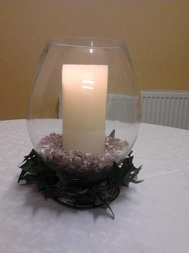 Flowers, Hurricane vase with candle, stones and ivy (centrepiece). Wedding packages available.