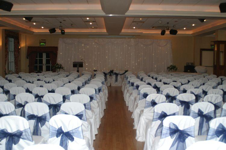 Decor & Styling, White chair covers and navy-blue sashes. Wedding flowers, church flowers, wedding c