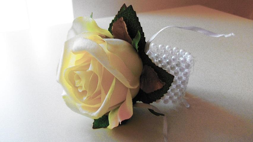 Flowers, Buttonhole (Pure Rose). Supplier of wedding flowers and silk arrangements.