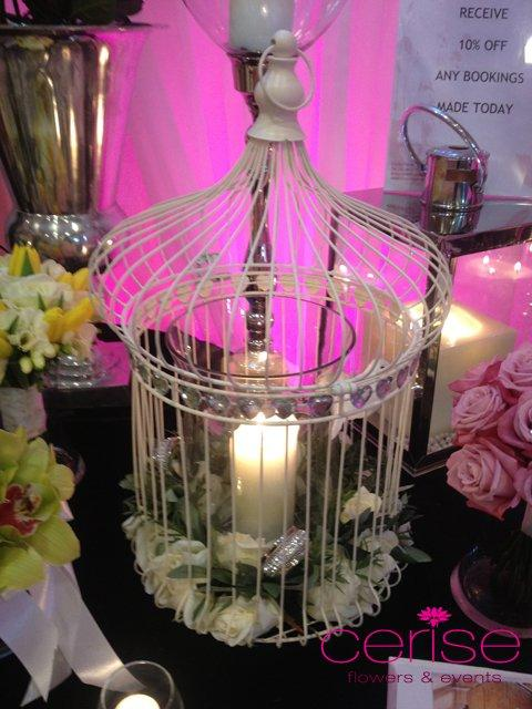 Decor & Styling, Bird cage, candle and flower arrangement. Services provided: wedding flowers, chair