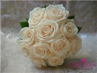 Flowers. Bridesmaid bouquet (white roses with diamante). Services provided: wedding flowers, chairco