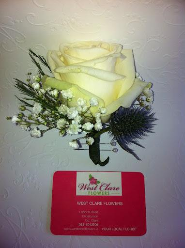 Flowers, White rose and thistle button hole. Flowers directly imported from Holland to ensure that o