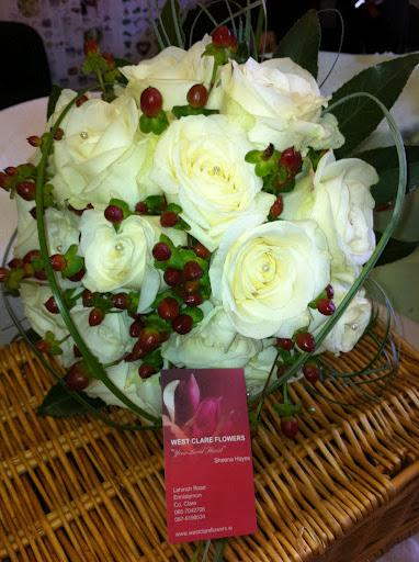 Flowers, White roses and hypericum bouquet. Flowers directly imported from Holland to ensure that on