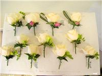 Flowers. Buttonholes. Large range of fresh cut flowers and plants available.