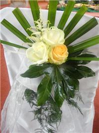 Flowers. Chair back flower arrangement. Large range of fresh cut flowers and plants available.