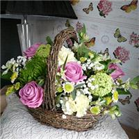 Flowers. Country Basket. Display of flowers that appear as if you have just taken them from your gar