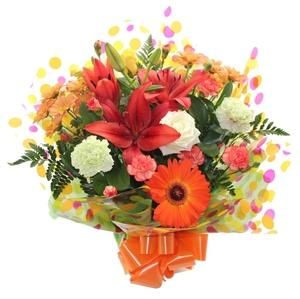 Flowers, Fresh & Funky Hand-Tied. A stunning bouquet in vibrant oranges.