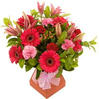 Flowers. Pink Delights. Various shades of pink in a hand tie. Blooms may vary.