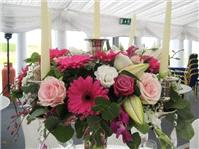 Flowers. Candelabra flower arrangement. Personalised wedding packages available.
