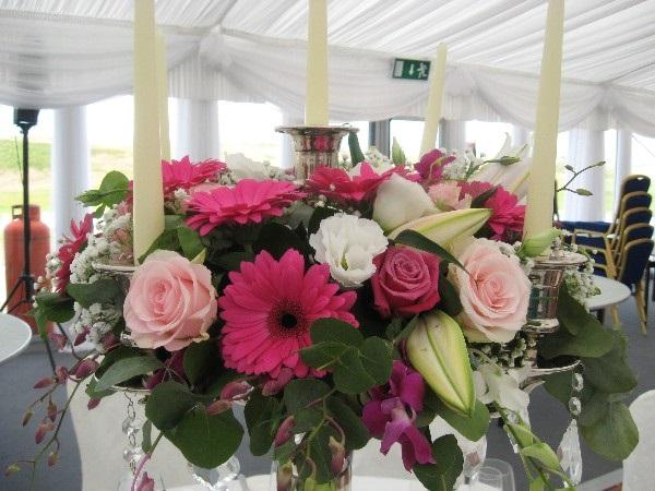Flowers, Candelabra flower arrangement. Personalised wedding packages available.