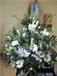 Flowers. Church flower arrangement. Personalised wedding packages available.