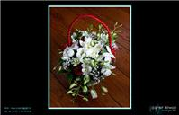 Flowers. Basket flower arrangement. Personalised wedding packages available.
