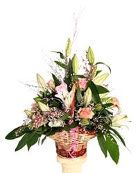 Flowers. Basket of Blooms - Lilies and Roses. Eye-catching display of lilies, roses and carnations.