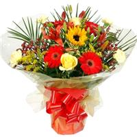 Flowers. Happy Days. Vibrant, hand-tied bouquet with elegant lilies, simple gerbera, bright carnatio