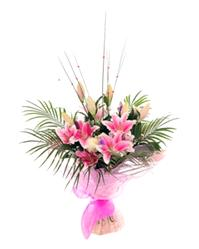 Flowers. Lilies Forever. Display of  oriental lilies together with roses and some flatteringly rich