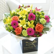 Flowers, Vibrant Hand-Tied. Bursting with radiant colour including hot pinks, rich oranges and glori