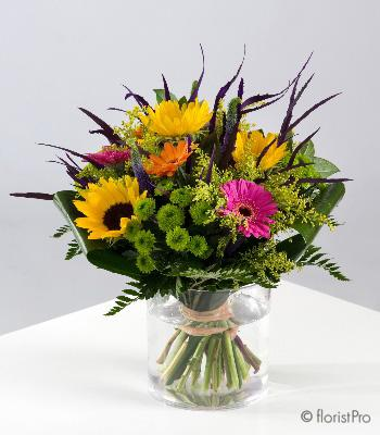 Flowers, Pippa. A vibrant mix of purples, greens and yellows. Only available in our local delivery a
