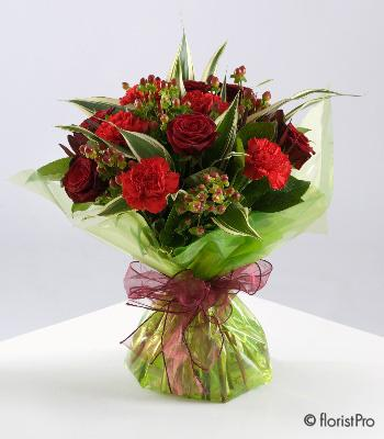 Flowers, Aimee. A beautiful hand-tied bouquet, elegantly wrapped containing a mixture of roses, carn