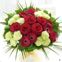 Flowers, Majestic Hand-Tied. Roses, deep red germinis and fresh green carnations.