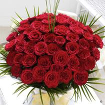 Flowers, Unforgettable 50-Rose Hand-Tied. 50 large-headed red roses hand-tied with palm and steel gr