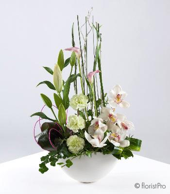 Flowers, Patience. A stunning modern arrangement of lilies, orchids, carnations and foliage set with