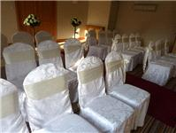Decor & Event Styling. Damask chair coves with golden satin sashes.
