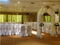 Decor & Event Styling. Floral arrangements with a white fabric arch.