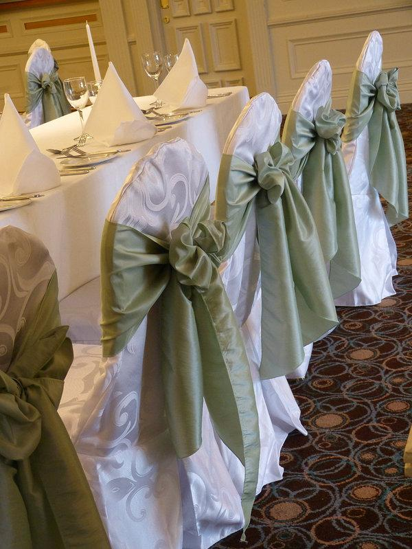 Chair Covers, White damask chair covers tied with an olive green satin sash.