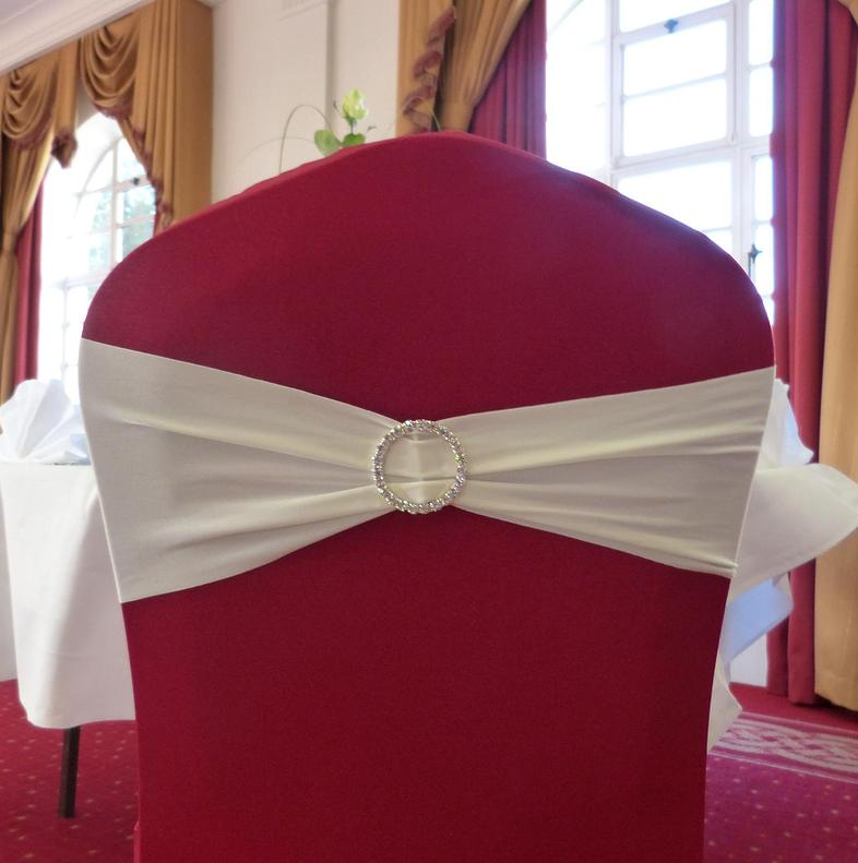 Chair Covers, Pink chair covers with a white satin tie and circular diamante pin.