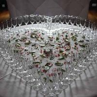 A Collection, Champagne glasses arranged in the shape of a love heart.