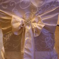 Chair Covers, Damask chair covers with cream satin sash.