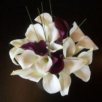 Brides Bouquets, White and deep purple lily bouquets.