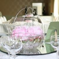 Centerpieces, Pink flowers floating in water in a large glass vase.