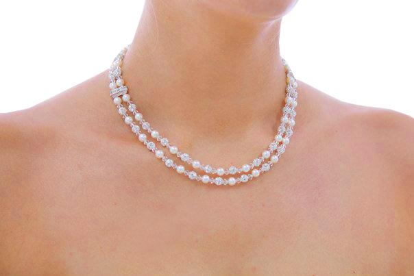 Jewellery, Double-strand Havana. 6 mm Swarovski pearls and Swarovski crystal necklace, with sterling
