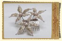 Jewellery. Medium Star Flower Hair comb, in dusty gold with champagne trim and large pearl centres.
