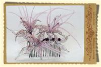 Jewellery. Beaded flowers and pale pink ostrich feather hair comb.