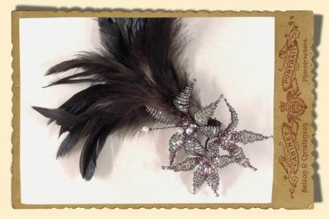 Jewellery, Flowers and Feathers. Beaded flowers with feathers.