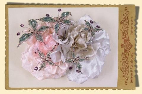 Jewellery, Flowers with Butterflies. Silk floral corsage with intricately beaded butterflies.