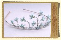 Jewellery. Classical tiara made in a simple delicate floral structure with blue detail.